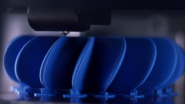 ld nozzle of the 3d printer gliding across a blue model of a propeller fan - propeller stock videos & royalty-free footage