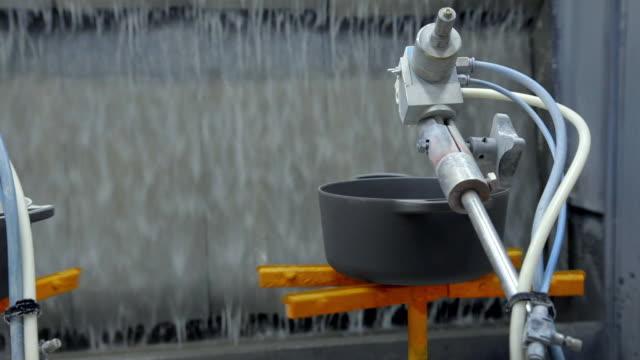 nozzles automatically spray enamel onto pots - cream coloured stock videos & royalty-free footage