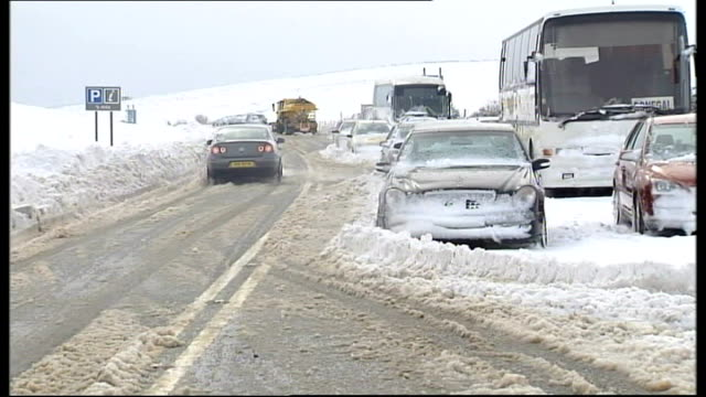 nr derry glenshane pass ext/snow on ground air views / aerials of snow covered countryside / vehicles stranded in snow at side of road snow plough... - snow vehicle stock videos and b-roll footage