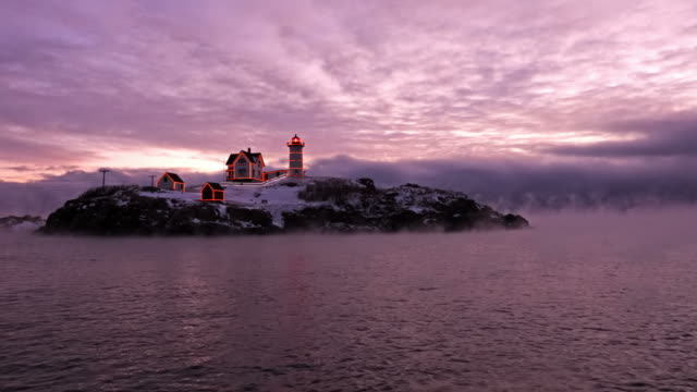 nubble lighthouse in arctic sea smoke - lighthouse stock videos & royalty-free footage