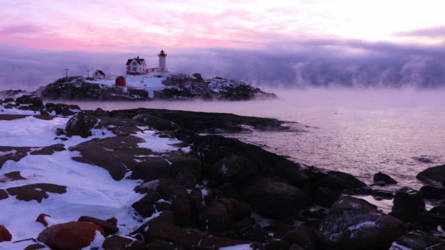 nubble lighthouse in arctic sea smoke - maine stock videos & royalty-free footage