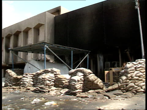 nuclear capability iraq kirkuk/karbala building pan lr wrecked sandbag position int gv wrecked interior of building lms people to fro as bomb wrecked... - sandbag stock videos and b-roll footage