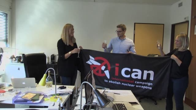 Nuclear disarmament campaign group ICAN celebrates after winning the Nobel Peace Prize for its efforts to consign the atomic bomb to history