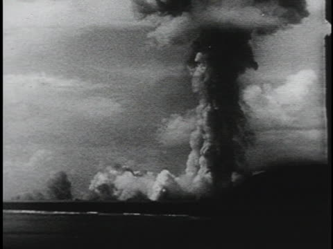 nuclear explosion fills the atmosphere with a dark cloud. - atomic bomb stock videos & royalty-free footage