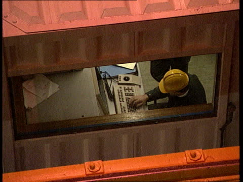 nuclear industry job cuts int sellafield thorp plant gv part of workings in nuclear plant as circular item moved slowly on overhead conveyor tms side... - plant part stock videos and b-roll footage