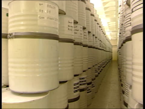 barrels of radioactive waste at sellafield; england: cumbria: sellafield: sellafield nuclear plant: int various of stainless steel drums stacked in... - warehouse点の映像素材/bロール