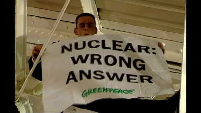 high court rules against government plans; r29110513 england: london: islington: design centre: int greenpeace protest at cbi conference - greenpeace stock videos & royalty-free footage