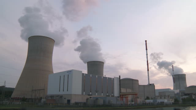 ws nuclear power plant at dusk / thiange, liege, belgium - smoke stack stock videos and b-roll footage