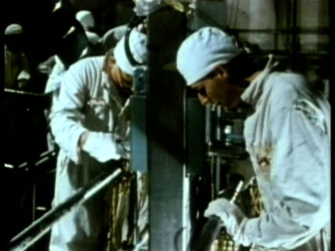 1985 montage ms nuclear power plant technicians lowering control rods into reactor core audio / three mile island, harrisburg, pennsylvania, usa - nuclear reactor stock videos & royalty-free footage