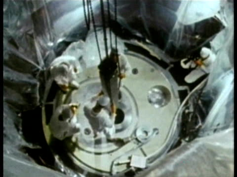 1985 montage ms nuclear power plant technicians lowering control rods into reactor core audio / three mile island, harrisburg, pennsylvania, usa - rod stock videos and b-roll footage