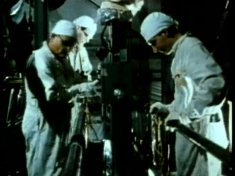 1985 montage nuclear power plant technicians working audio / usa - nuclear reactor stock videos & royalty-free footage