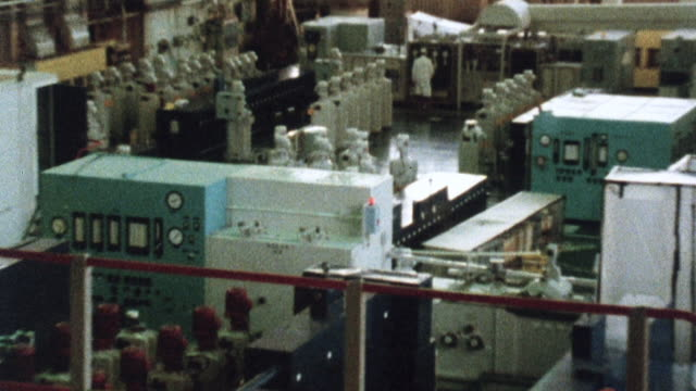 1981 montage nuclear power plant with systems operation above ground and nuclear power systems below and beneath concrete protection / united kingdom - nuclear power station stock videos & royalty-free footage