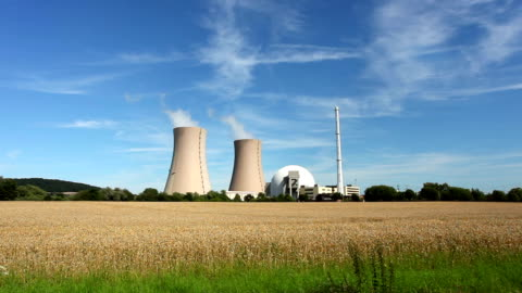 nuclear power station and wheatfield - real time - nuclear energy stock videos & royalty-free footage
