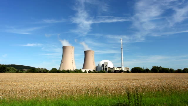 nuclear power station and wheatfield - real time - nuclear power station stock videos & royalty-free footage