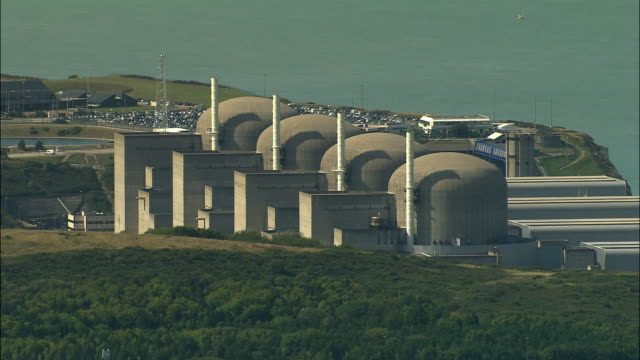 low aerial, nuclear power station, saint-valery-en-caux, france-haute normandy, france - atomkraftwerk stock-videos und b-roll-filmmaterial