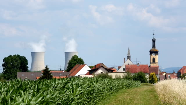 Nuclear power station with village in the foreground