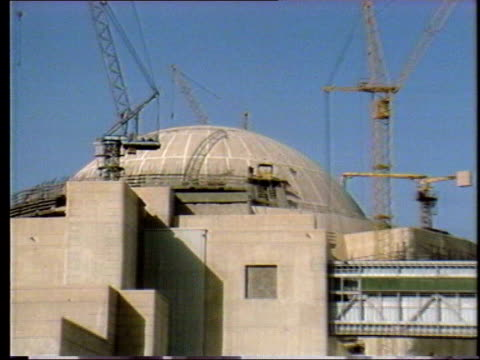 nuclear programme restarted; lib iran: ext nuclear plant under construction zoom in int equipment inside plant tilt up equipment being constructed... - nuclear power station stock videos & royalty-free footage