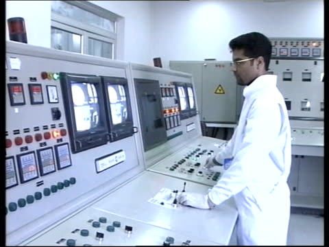 rice keeps up pressure; date unknown ??? air view iranian nuclear power plant int gvs machinery and people working inside nuclear processing plant - krishnan guru murthy stock videos & royalty-free footage
