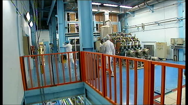 uranium enrichment continues despite un sanctions isfahan int general views of workers and people inside uranian conversion plant tilt up people... - uran stock-videos und b-roll-filmmaterial