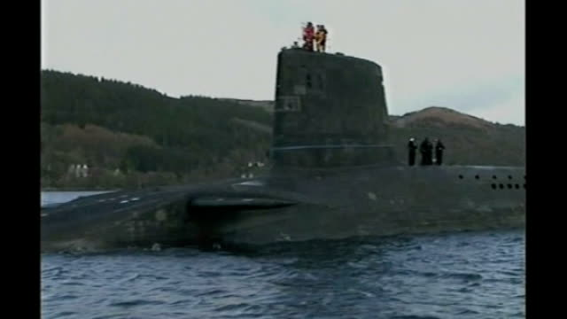 nuclear reactors powering royal navy submarines fail safety standards; r04120607 scotland: faslane naval base: ext trident nuclear submarine on... - nuclear reactor stock videos & royalty-free footage