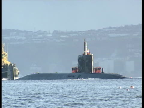 Faslane Partially submerged nuclear submarine HMS Trafalgar along thru water on return to dock Crew on top of vessel as thru water with coastguard...