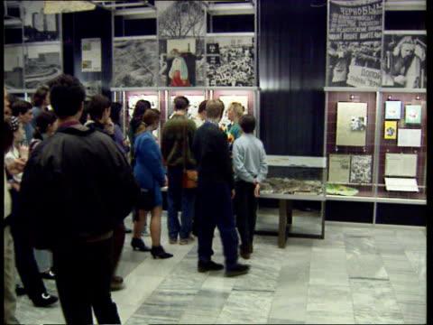 nuclear waste disposal: pacific pintail: chernobyl:; b)c4n russian federation: ukraine: kiev chernobyl museum: tls visitors along as looking at... - bericht film und fernsehen stock-videos und b-roll-filmmaterial