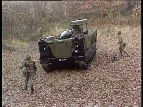 nuclear weapons cuts - britain follows; germany army vehicle towards carrying lance missile and stops as british soldiers in camouflage round it bv... - nuclear weapon stock videos & royalty-free footage