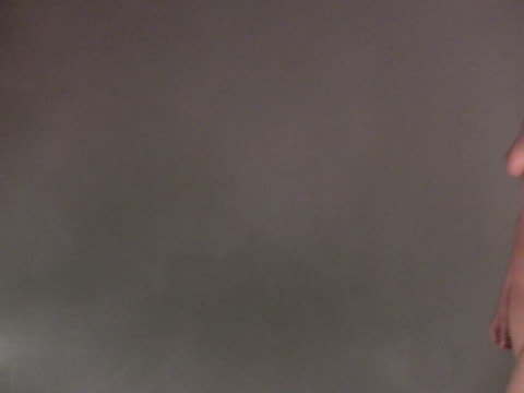 stockvideo's en b-roll-footage met nude walks past camera through fog - moving past