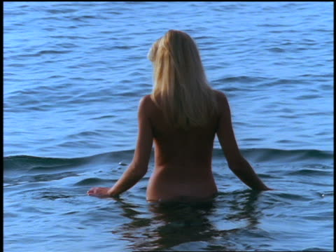 rear view nude woman standing in body of water / corsica - 1998 stock videos and b-roll footage