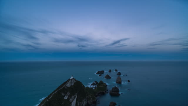 nugget point lighthouse new zealand at night - seascape stock videos & royalty-free footage