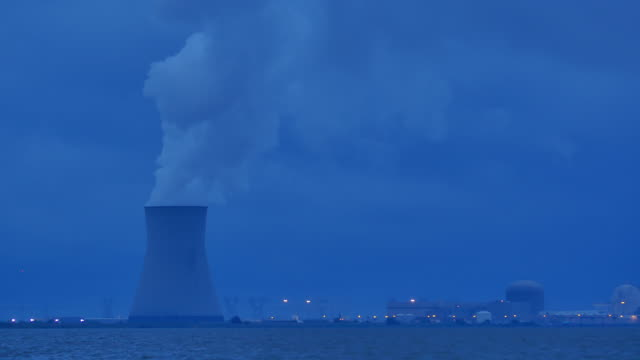 nuke power cooling tower blue closer at dusk 4k - nuclear power station stock videos & royalty-free footage