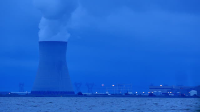 nuke power cooling tower blue night at dusk 4k - nuclear power station stock videos & royalty-free footage