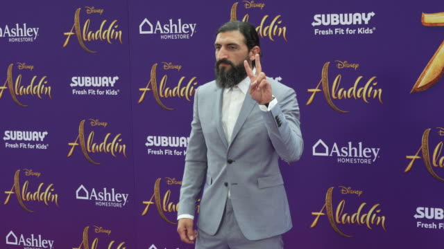 """numan acar at the world premiere of disney's """"aladdin"""" on may 21, 2019 in hollywood, california. - light blue stock videos & royalty-free footage"""