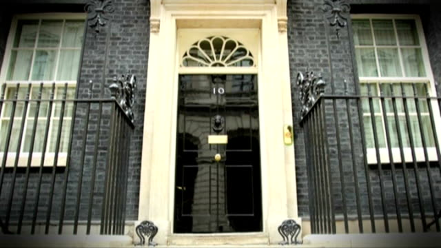 london downing street number 10 door as people come and go - replacement stock videos & royalty-free footage