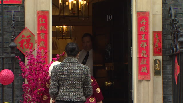 number 10 downing street being decorated outside for chinese new year including fortune cookies being carried inside - chinesisches laternenfest stock-videos und b-roll-filmmaterial