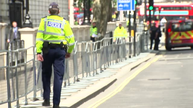 number 10 put on lockdown with road closures as officers investigate suspicious item england london whitehall ext police van along to officers /... - single object stock videos & royalty-free footage