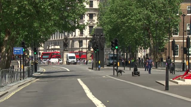 number 10 put on lockdown with road closures as officers investigate suspicious item england london whitehall ext bomb disposal robot in road /... - single object stock videos & royalty-free footage