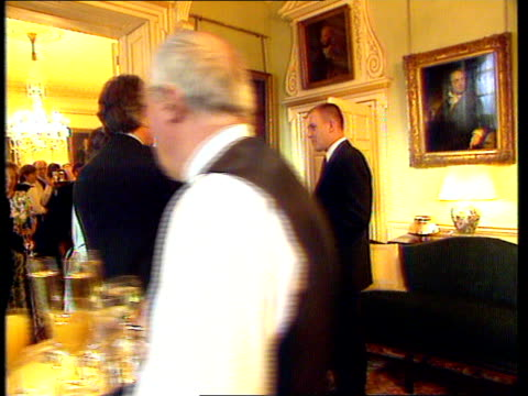 number 10 showbiz party; bbc pool downing st: gallagher chatting to tony blair mp at party - number stock videos & royalty-free footage