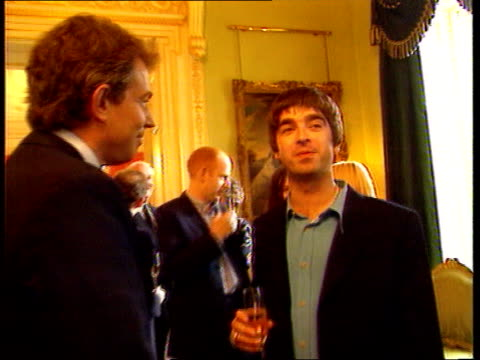 number 10 showbiz party; england: london: downing street: number 10: int musician noel gallagher chatting to prime minister tony blair mp chef delia... - number stock videos & royalty-free footage