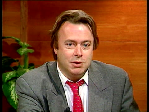 Number 10 showbiz party ITN Hitchens intvwd Showbusiness personalities draw bigger crowds ENGLAND London Downing St No 10 CS Champagne being poured...