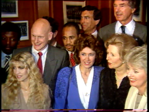 number 10 showbiz party; lib downing st: then pm margaret thatcher posing with celebrities including bob monkhouse, jan leeming, trevor brooking,... - bob monkhouse stock videos & royalty-free footage