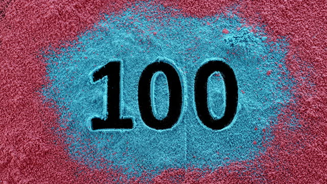 slo mo ld number 100 appearing in the blue and red dust - coloured background stock videos & royalty-free footage