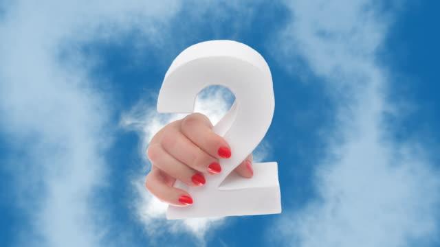 stockvideo's en b-roll-footage met nummer 2 in de hand wordt weergegeven door een wolk - diavoorstelling