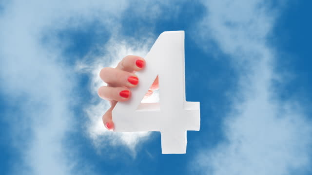 number 4 in hand shows up through a cloud - number 4 stock videos & royalty-free footage