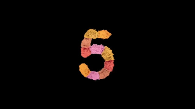 number 5 created with powder in warm colors exploding towards camera in super slow motion and closeup on black background - number 5 stock videos & royalty-free footage