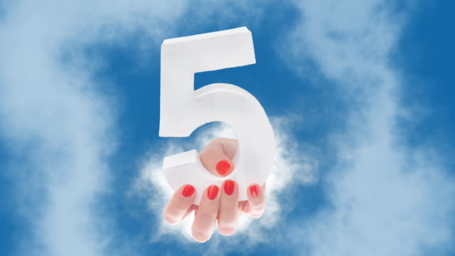 Number 5 in hand shows up through a cloud