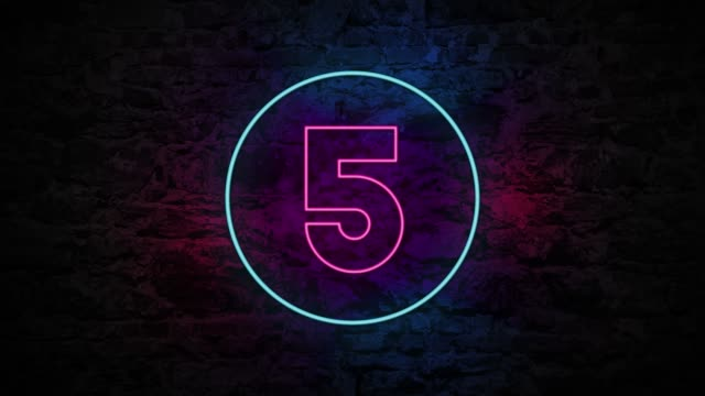 number 5 neon sign on brick background 4k animation - number 5 stock videos & royalty-free footage