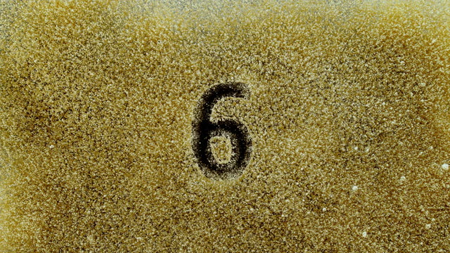 slo mo ld number 6 appearing in the golden dust - number 6 stock videos & royalty-free footage