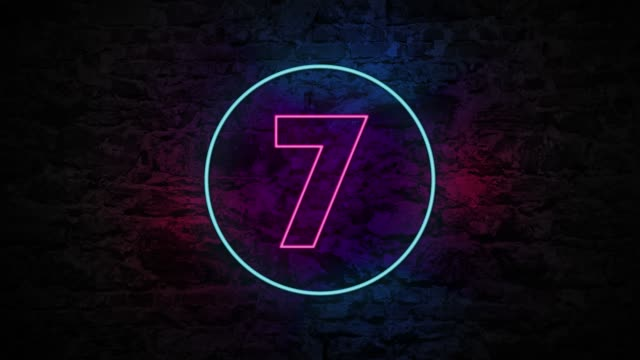 number 7 neon sign on brick background 4k animation - number 7 stock videos & royalty-free footage