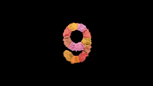 number 9 created with powder in warm colors exploding towards camera in super slow motion and closeup on black background - number 9 stock videos & royalty-free footage